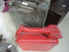 A 1952 dated War department petrol can and similar in red with integrated pouring spout.