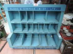 A Globe and Simpson parts rack or shelf unit in blue wood.