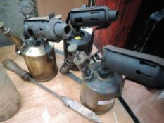 Three brass blow torches and soldering iron.