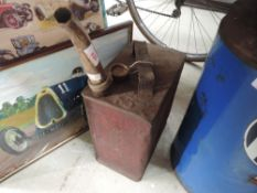 An original Shell motor spirit petrol can with nozzle