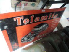 A vintage tin Telamite sign.