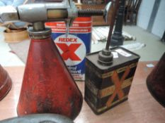 A Redex dispenser and two Redex cans.
