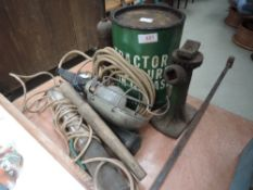 A selection of Grease guns, tin of tractor grease, inspection lamps and early car jack.