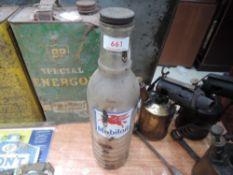 A glass Mobiloil oil bottle with original cap.