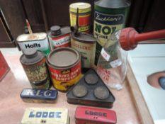A selection of garage advertising tins car polish and Duckhams Nol oil