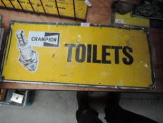 A Champion spark plugs adverting sign for Toilets.