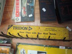 A vintage Tridon Hose clip rack.