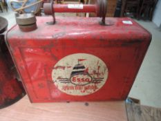 A scarce 18 pint petrol can advertising Esso motor boat services.