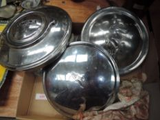 Three car hub caps, for Jaguar, Austin and Wolsey and an assortment or vintage key rings.