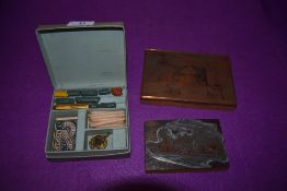 Two vintage printing plates and a Dennisons letter wax set.