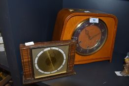 Two vintage wooden mantel clocks the large one being Smiths and having chiming mechanism.