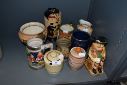 A selection of vintage vases and tankards and condiment jars, various styles and sizes.