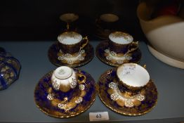 A set of six tea cup and saucer sets by Aynsley having deep blue and gold transfer design all pieces