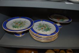 A selection of antique serving plates in hard paste having individual hand painted floral scenes