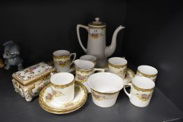 A Noritake part coffee set comprising of six cups and saucers,sugar basin, creamer and coffee pot,