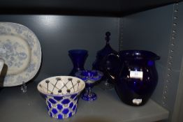 A selection of blue and white glass wares including cut cameo and Bristol blue water jug