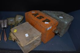 A selection of military communications devices including field telephone