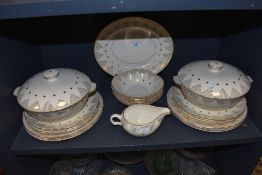 A part dinner service by Alfred Meakin with cream and gold design
