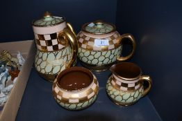 A part tea service by Sadler with green and lustre glaze