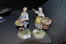 Two Dresden styled figure bases of flower sellers both hand decorated