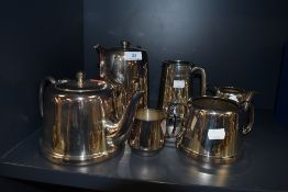 A tea set in polished steel with art deco design