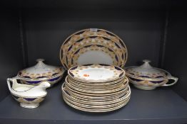 A part dinner service marked B.P made in Scotland with Imari style design