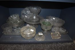 A collection of vintage pressed glass including dressing table sets, bowls and tazzas.