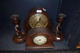 Two art deco mantle clocks including rose wood style case and twist stem candle sticks