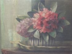 An oil painting, Ila Adams, Flower study, signed and attributed verso, 30 x 39cm, framed and glazed
