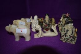 A selection of cast and carved Chinese and similar oriental figures including Elephant, Nude lady