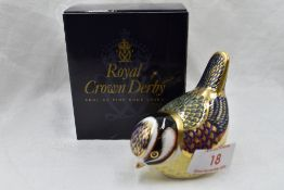 A Royal Crown Derby Blue Tit paperweight, boxed with gold stopper