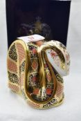A Royal Crown Derby Snake paperweight, boxed with gold stopper