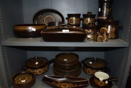 A large selection of dinner and table wares by Denby in the Arabesque design