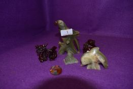 A selection of small stone carved figures including parrot Buddah and agate ring