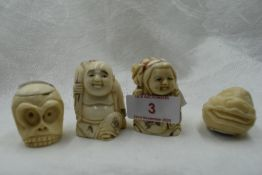 A selection of hand carved Japanese Netsuke and Okimono including double faced monkey head, Moks and