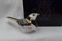 A Royal Crown Derby Pied Wagtail paperweight, boxed with gold stopper