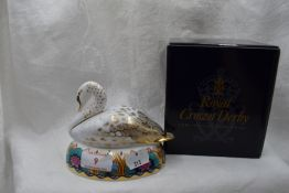 A Royal Crown Derby Swan paperweight, boxed with gold stopper