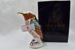 A Royal Crown Derby Hummingbird paperweight, boxed with gold stopper
