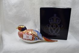A Royal Crown Derby Pheasant paperweight, boxed with gold stopper