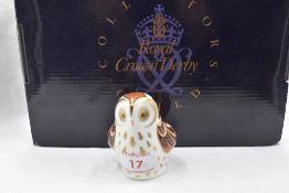 A Royal Crown Derby Collectors Guild Owlet paperweight, boxed with gold stopper