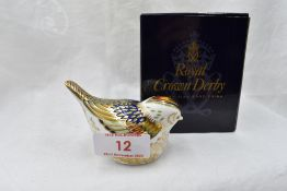 A Royal Crown Derby Firecrest paperweight, boxed with gold stopper