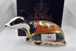 A Royal Crown Derby Moonlight Badger paperweight, boxed with gold stopper