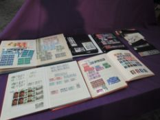 A Collection of GB Stamps in six albums and loose, mainly mint Queen Elizabeth II