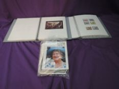 Two Albums containing mint & used Isle of Man & Jersey Stamps, along with Isle of Man Newsletters