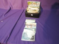 A box of vintage and modern Postcards