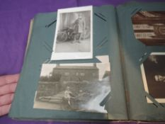 A Vintage Postcard Album containing many early Military Real Black & White cards