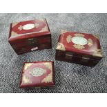 A selection of oriental jewellery cases having carved Jade style panels to top