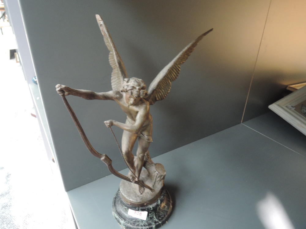 A Victorian French spelter figure of an angel stringing bow on marble base