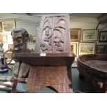 A traditional heavy ethnic wood hand carved African Palavar chair having tree detail to back