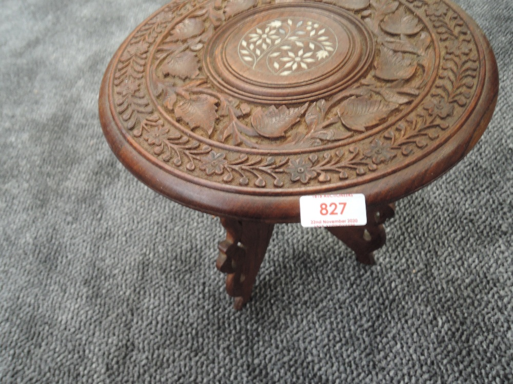 A small hand carved Indian table
